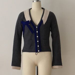Field Flower wool cardigan with playful appliqué